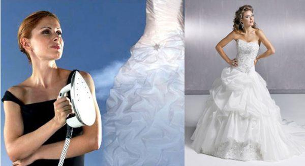 Женщина , держащая утюг для глажки свадебного наряда
